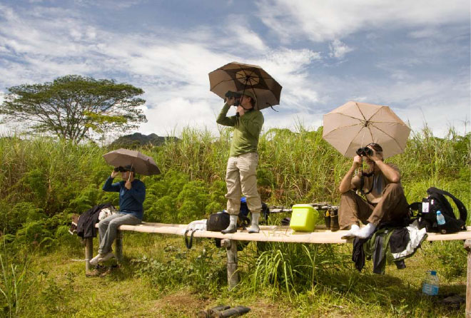 Birders scan the skies at the Mount Kitenglad eagle viewpoint.
