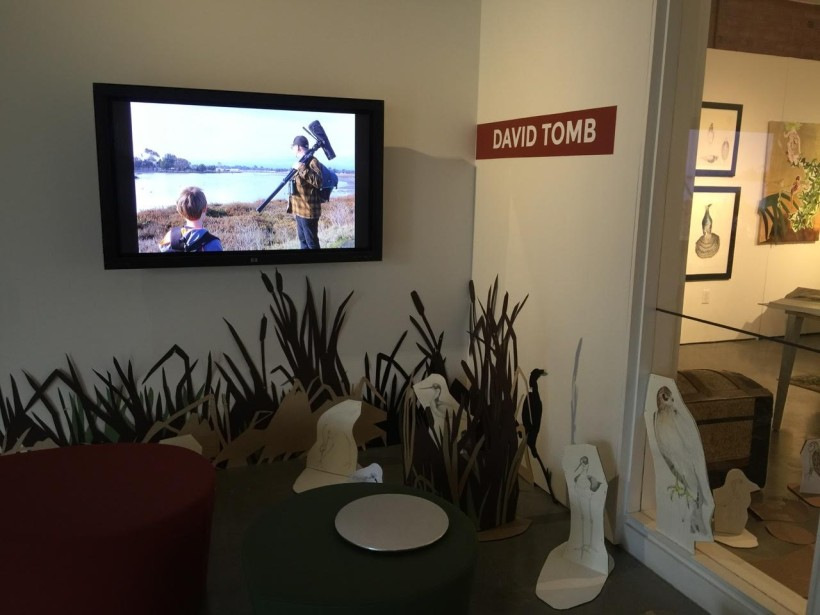 Entry to exhibit with monitor showing a photo of David Tomb giving a wildlife tour